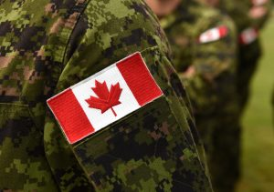 Canada patch flags on soldiers arm